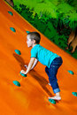 Little boy climbing at the hill Stock Photography