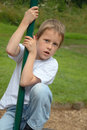 Little boy climbing pole on playground Stock Photography