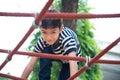 Little boy climbing rope at playground