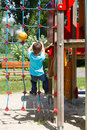 Little boy climbing on rope at playground outdoor Royalty Free Stock Images