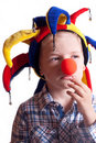 image photo : A little boy with a clown nose clown in a hat