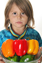 Little boy with colorful peppers Stock Photography