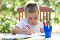 Little boy coloring outside Stock Photos