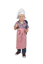 Little boy in cook chef hat and big spoon in hand Royalty Free Stock Photo