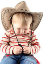 Little boy in cowboy hat Stock Images