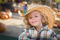 Little boy in cowboy hat at pumpkin patch adorable wearing farm Royalty Free Stock Images
