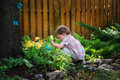 Little Boy Crouching Down Looking for Easter Eggs Royalty Free Stock Photo