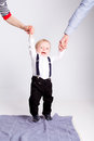 Little boy cry holding parents on white background hands Royalty Free Stock Photo
