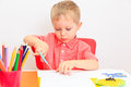 Little boy cutting from paper early learning and daycare concept Royalty Free Stock Image