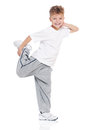 Little boy dancing on white