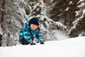 Little boy in deep snow winter Stock Photos