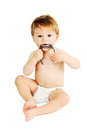 Little boy in a diaper plays with wristwatch white background Stock Photos
