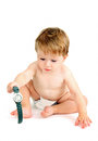 Little boy in a diaper plays with wristwatch white background Royalty Free Stock Images