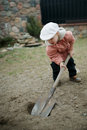Little boy digging a hole Royalty Free Stock Photo