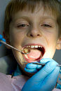 Little boy with a doctor in dental surgery shot of healthcare medicine Stock Photography