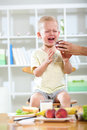 Little boy does not want to eat crying Stock Photos