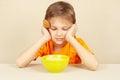 Little boy does not want to eat porridge a Royalty Free Stock Photos