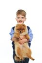 Little boy with dog happy holding spitz Royalty Free Stock Photography