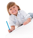 Little boy drawing on the floor isolated over white Royalty Free Stock Photos