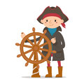 Little boy dressed as sailor, pirate captain holding ship wheel