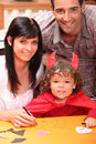 Little boy dressed in devil parents and a Stock Photography