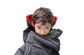 Little boy dressed up as dracula for the halloween party on white bacground Royalty Free Stock Photos