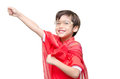 Little boy is dressed up as a superhero flying on white background Royalty Free Stock Images