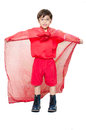Little boy is dressed up as a superhero flying on white background Royalty Free Stock Photo