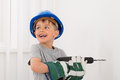 Little Boy Drilling Wall Royalty Free Stock Photo