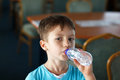 Little boy drink water from bottle Royalty Free Stock Image
