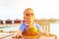 Little boy drinking coconut cocktail on tropical Royalty Free Stock Photo