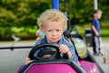 A little boy driving a bumper car at the carnival Stock Photography