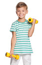 Little boy with dumbbells Royalty Free Stock Photo