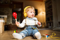 Little boy with earphones, listening music and plying musical in Royalty Free Stock Photo