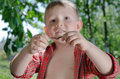 Little boy with an earthworm in his hands Royalty Free Stock Photo