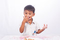 Little boy eating cake Royalty Free Stock Photo