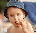 Little boy eating a cookie portrait of at the beach Stock Image