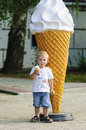 Little boy eating ice cream in the park Royalty Free Stock Images