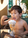 Little boy eating ice cream portrait of years old dessert Royalty Free Stock Photography