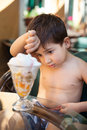 Little boy eating ice cream portrait of years old dessert Stock Photography