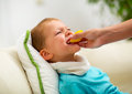 Little boy eating a lemon at home Royalty Free Stock Photo