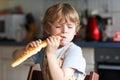 Little Boy Eating Long Loaf Br...