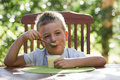 Little boy eating pudding Royalty Free Stock Photography