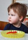 Little boy eating sweet and has a dirty mouth Royalty Free Stock Photography
