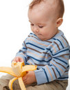 Little boy eats banana Royalty Free Stock Photography