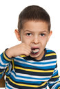 Little boy eats spoon white background Royalty Free Stock Photo