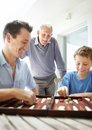 Little boy enjoys a game with his father Royalty Free Stock Image