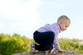 Little boy exploring climbing a rock Royalty Free Stock Photo