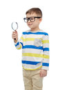 Little boy in eyeglasses with magnifying glass Royalty Free Stock Photo