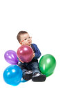 Little boy with eyeglasses playing with colorful balloons isolated Stock Photos